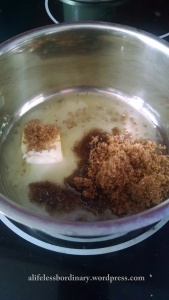 Melt two tablespoons of butter and 1/4 cup of brown sugar in a saucepan.